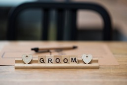 Groom place setting scrabble tiles