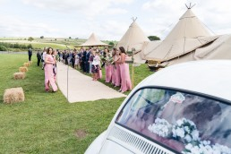 arriving at a tipi wedding