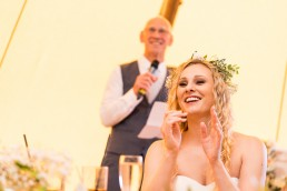 bride listening to her dad give a speech