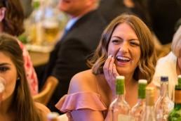 laughing bridesmaid