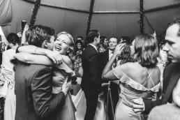 big hugs at a wedding